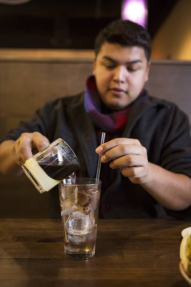 Pouring Vietnamese Iced Coffee